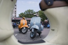 GERMANY LEISURE VESPA (1).jpg:epa04187717 Vespa mopeds are parked on Wittenbergplatz in Berlin, Germany, 01 May 2014. Every year on May 1, moped enthusiasts meet for the so-called 'Anrollern' (start rolling) to take a group trip outside of Berlin. EPA/FLORIAN SCHUH